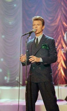 This classic look is how many younger fans will remember Bowie. Here, he performs on The Tonight Show With Jay Leno on May to promote his studio album, 'Black Tie White Noise. Black Tie White Noise, Images Of David Bowie, Bowie Starman, The Thin White Duke, Major Tom, Ziggy Stardust, David Jones, Brixton, The Man