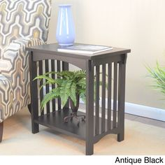This Mission style accent table is a great piece to place in a living room, home office, entry way or many other spaces. It features a low fixed shelf for decorative piece may be displayed underneath the table surface.