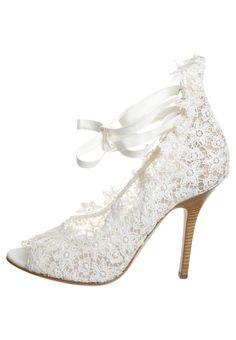 Ferretti lace pumps. I like lace.. so feminine.