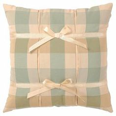 """Bring a cottage-chic touch to your bed or favorite reading nook with this charming pillow, featuring a plaid motif and bow details.   Product: PillowConstruction Material: Polyester and rayon cover and polyester fillColor: Cream and blue greenFeatures:  Insert includedZipper closureDimensions: 14"""" H x 13"""" W x 4"""" DCleaning and Care: Dry clean. Spot clean only."""
