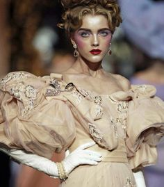 Christian Dior haute couture f/w 2007. This collection features big sleeves, embellished gowns, cinched waist, full skirts that were all characteristic of the Romantic period.