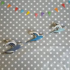 Check out this item in my Etsy shop https://www.etsy.com/uk/listing/498155849/ceramic-flying-budgies-in-blues