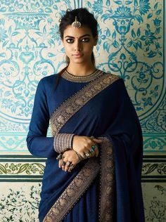 Want to check out best full neck blouse designs of this year? Here are 23 latest models you can wear with any saree! Want to check out best full neck blouse designs of this year? Here are 23 latest models you can wear with any saree! Blouse Back Neck Designs, Sari Blouse Designs, Saree Blouse Patterns, Latest Blouse Designs, Modern Blouse Designs, Neckline Designs, Trendy Sarees, Stylish Sarees, Sabyasachi Sarees