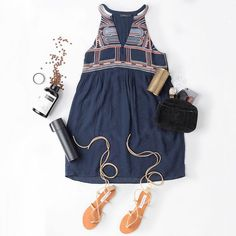 We paired this Grecian-inspired embroidered halter dress with a gold statement bracelet, a black clutch, lace up sandals, and our favorite coffee in this flatlay. Find more at www.thmlclothing.com