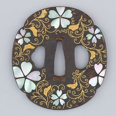 Floral tsuba with mother of pearl inlay