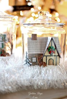 Winter village made of paper and glitter in glass cookie jars with salt as snow - www.goldenboysandme.com