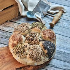 An olive oil-rich loaf with lots of seeds and toppings. A great bake with kids #bread #recipe #baking Bread Tin, Spice Bread, Caraway Seeds, Fennel Seeds, Springform Cake Tin, Nigella Seeds, Baking Parchment, Dough Balls, Baking With Kids
