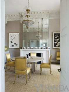 Eighteenth century Viennese chair sit under a Jansen chandelier in Veere Grenney's London apartment.