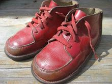 My little red tie shoes made by Buster Brown. We got them from Pisini's Shoe store in Franklin, MA