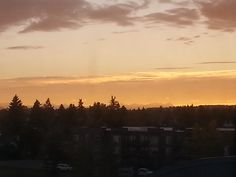 Sunset in Calgary, with the mountains in the background.
