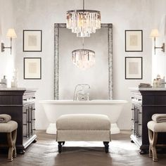 Glamorous black and white bathroom with freestanding tub