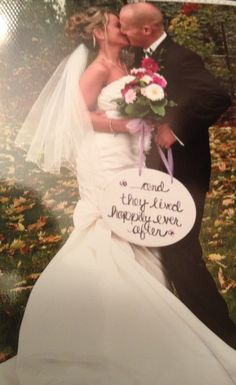 ...and they lived happily ever after vow renewel picture idea  holding a book that says this