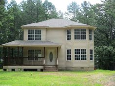 Private setting in the country is where this 3 bd 2.5 ba on 6.10 wooded ac. is located. There is also a 2 car garage and wrap around deck all of this at a price that's pleasing to your families budget in Mena AR