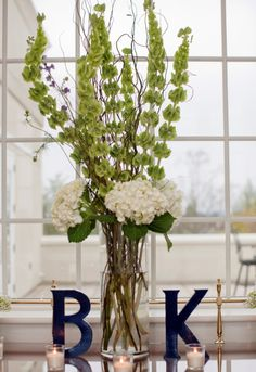 White Green and Navy Wedding.... I don't really care for the colors but I like the initials on each side.