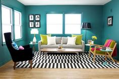Teal Living Room With Black and White Rug | HGTV
