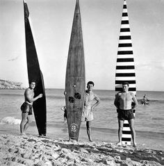 Bondi, c. 1950  In 1788 Captain Cook reported long board riding was popular in Hawaii. Duke Kahanamoku introduced the sport here in 1915 and long boards remained popular until the late 1950s.   Then short, lightweight Malibu boards arrived from California, first plywood, then solid balsa, finally plastic... and the rest is history.