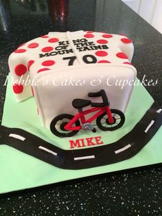 Cycling themed birthday cake. Spotty jersey, king if the mountains