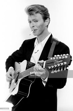 David Bowie poses with a Takamine twelve-string guitar at the Rainbow Theatre, London, 1990.