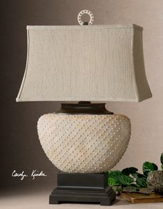 eaded ceramic base finished in a pale sandstone with dark bronze details. The rectangle bell shade is khaki linen fabric with natural slubbing.  Designer:Carolyn Kinder Wattage:150W Number of Bulbs:1 Dimensions:29 H Shade 13 W X 18 D (in) Weight (lbs):16 Ship Via UPS:Yes