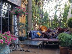 Boho bohemian garden room living space rich fabric and beautiful flowers