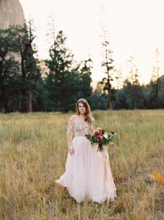 Natural bridal inspiration set at Yosemite National Park with incredible mountain scenery and a dreamy Haley Paige gown.
