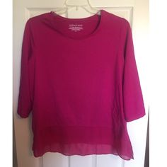 Plum (pinkish) top with shear material Plum (pinkish) top with shear material along the bottom hem.  3/4 sleeves. Worn maybe once if at all. Westbound Woman Tops Blouses