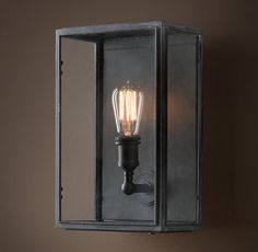"""Union Filament Wide Sconce Clear Glass  9""""W x 6¼""""D x 14""""H  Backplate: 8""""W x 1""""D x 12¾""""H"""