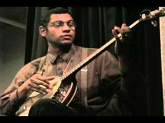 "Dom Flemons of Carolina Chocolate Drops at the  ""Black Banjo Gathering"", Symposium on Affrilachia, Hosted by University of Kentucky, Africana Studies.   Some music highlights and history on the roots.  Dom plays three instruments in this clip, but sadly, no bones."