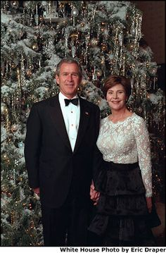 The President and Mrs. Bush stand in front of the White House Christmas Tree. 2001