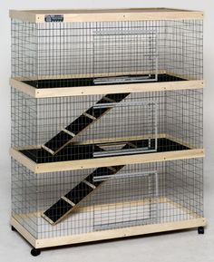 3 level rabbit hutch. Looks comfy and could hold a few does. I could build something like this!
