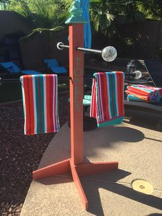 Towel hanger; Pool décor; coral and teal.