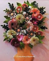 Gorgeous quilled flowers by a Russian crafter.