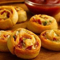 Appetizers: Crescent Bacon Cheddar Pinwheels. Ingredients: Crescent Rolls, Bacon, Cheddar cheese, & Green Onions.