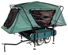 "Midget Bushtrekka for bicycle touring. TentCot on the top, storage on the bottom. Bed size 90""L x 32""W, trailer weight 56 lbs.  899.99 dollars."