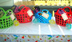 pool party gift baskets, beach towels, flip-flops, treats, summer kids party. Baskets,flip flops,beach towels and dancing flower bought at $ store. Name tags printed out from betterhomesandgarden.com.  Check out the board this is pinned to below to see all the pool party ideas we used