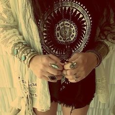 Cut-Off Black Shorts, Black Graphic T, Light-Weight White Lace Outerwear, Brass Cuff Bracelets... Edgy Summer Bohemian!