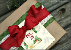 Vintage Inspired Christmas gift wrap idea. Layered ribbon and a vintage Christmas card dress up brown Kraft Paper .