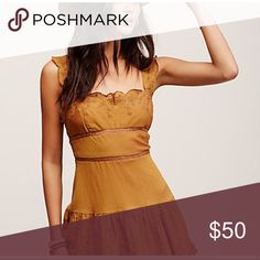 "Free People ""Angelica"" Mini Slip Dress Sold out everywhere!!  Another dress just hanging around, hoping to wear it someday. I love this. Beautiful ginger/gold color.  This dress would work better on someone that has medium to larger breasts. If you're smaller in that area, fashion tape on sides would do the trick. Worn once, and that's what I did. Backless, with tie enclosure in back on waist.  100% cotton. 32"" long. Submit Offer!! Free People Dresses Mini"