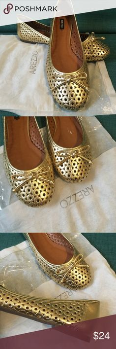Gold Arezzo Flats Metallic gold flats - never worn! Purchased on vacation in Brazil. Size 7.5-8 US. Size 37 Brazil.  Well made, cushioned and back heel cushioned as well. Arezzo Shoes Flats & Loafers