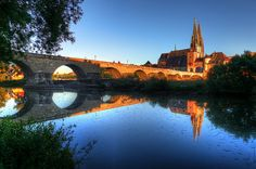 Reflection of the stone bridge and the cathedral of Regensburg