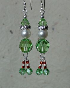 These are so cute they make me giggle! Swarovski crystal Xmas Elf Earrings. Peridot Swarovski crystals & pearls w/ rinestone rondelles, glass bead accents, and sterling silver ea rwire. 2.25 from top of earwire to bottom of santas sparkly boots. Such a festive addition to the holidays