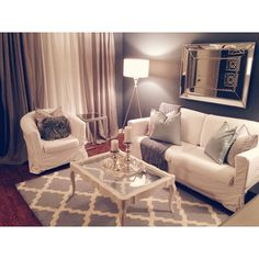 I can't get enough of our living room! Hayworth Mirror | Ikea furniture | Thrift store coffee table DIY | Moroccan Rug | Pier 1 Imports | Hayworth Collection | Target | Mercury glass accents
