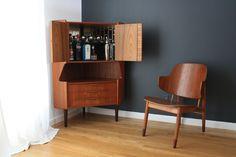 Danish Modern Teak Corner Bar Cabinet by Omann Jun | From a unique collection of antique and modern corner cupboards at https://www.1stdibs.com/furniture/storage-case-pieces/corner-cupboards/