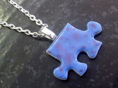 Puzzle Piece Necklace with Chain by TheHotSpotPC on Etsy, $6.00  ... bet i could DIM - do it myself!
