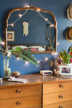 The mirror was purchased from the Brooklyn Flea Market. The dresser is also from John Ricciardelli at the Brooklyn Flea.