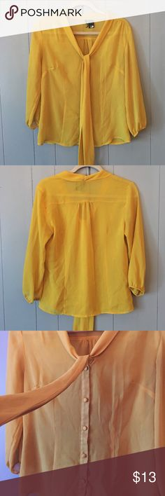 Gorgeous Mustard Yellow Blouse✨ This top is so pretty! It's a button up with a tie/scarf down the front. Semi-sheer. It looks flawless but closer examination does show some areas of stitch loosening. (See last pic). However it doesn't at all take away from the beauty of this blouse! It just needs to be treated with extra love and care. 😍 100% Polyester. new directions Tops Blouses