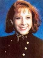 Major Megan Malia McClung USMCR (USNA 1995) killed in action. She was serving as a public affairs officer in the Second Battle of Ramadi.  She was killed in action on December 6, 2006 when the Humvee she was riding was destroyed by an improvised explosive device. She is the first female graduate and first female Marine Corps officer killed in action. At the time of her death she was highest ranking female officer ever posthumously awarded the Bronze Star and Purple Heart medals.