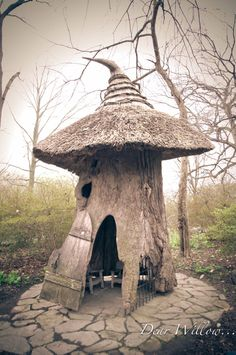 Hobbit House by DearWillowphoto on Etsy, $65.00  Awesome! Looks like Gandalf's hat!