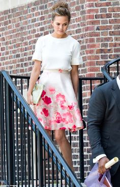 Pretty: The Sports Illustrated model wore a Lela Rose skirt and her brunette tresses in a ...
