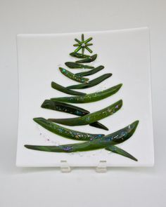 christmas tree plate. dichro dust sprinkled on the evergreen. Option stringer with coarse frit . . . put a bird on it :-p
